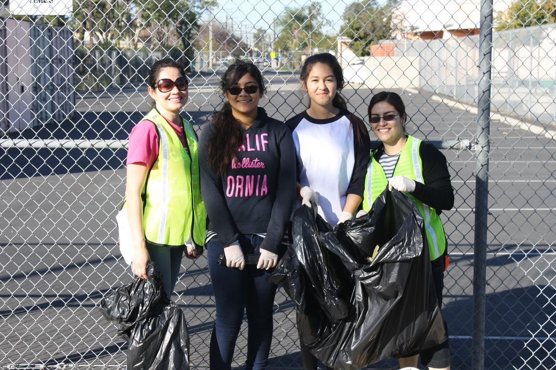 Group of Young Women Volunteers Carrying Trash Bags