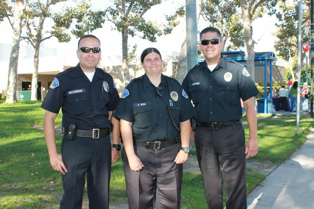 Three Public Safety Officers Smiling